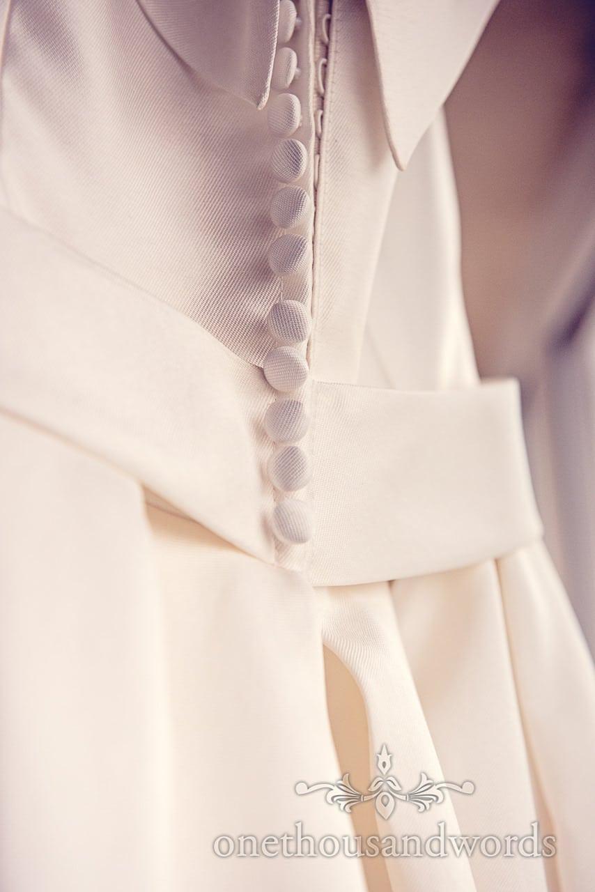 White retro 1950's wedding dress button detail photograph