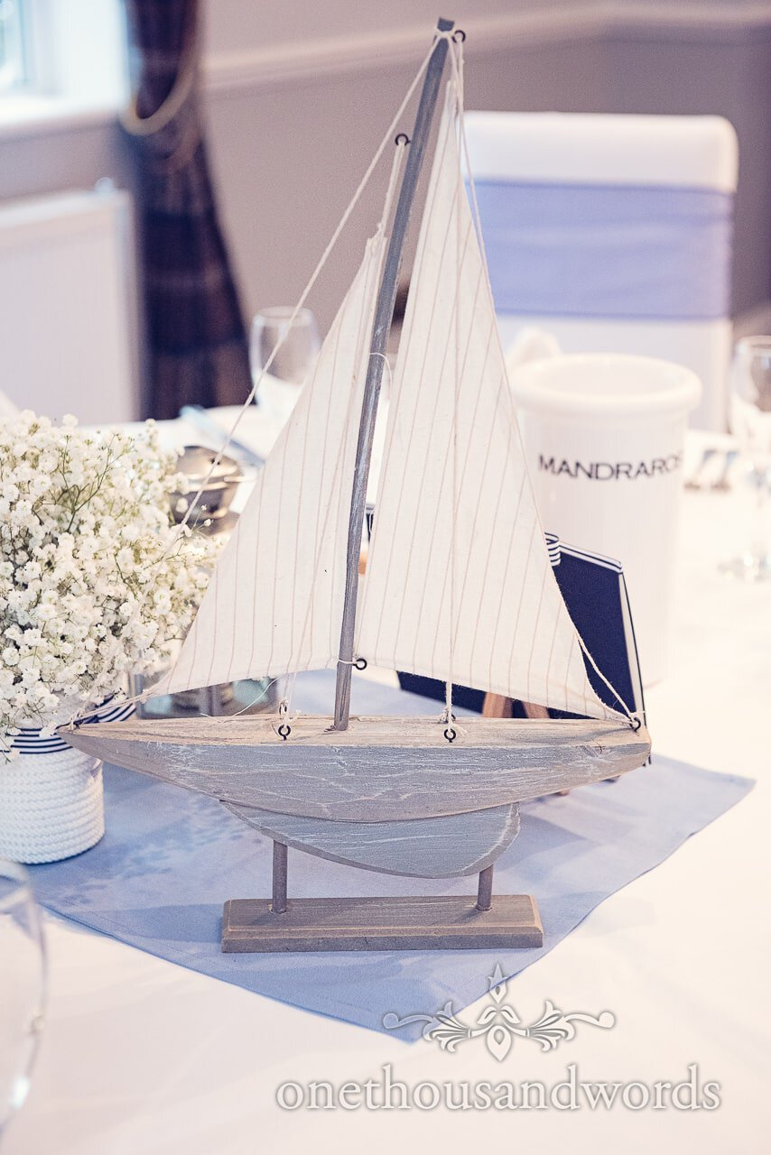 Wooden boat table decoration at nautical themed wedding