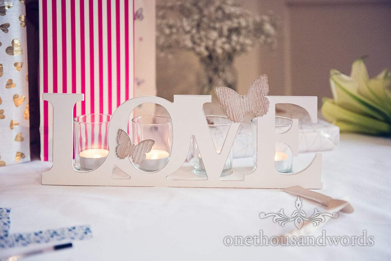 Wooden Love sign with butterflies at Harbour Heights Hotel Wedding