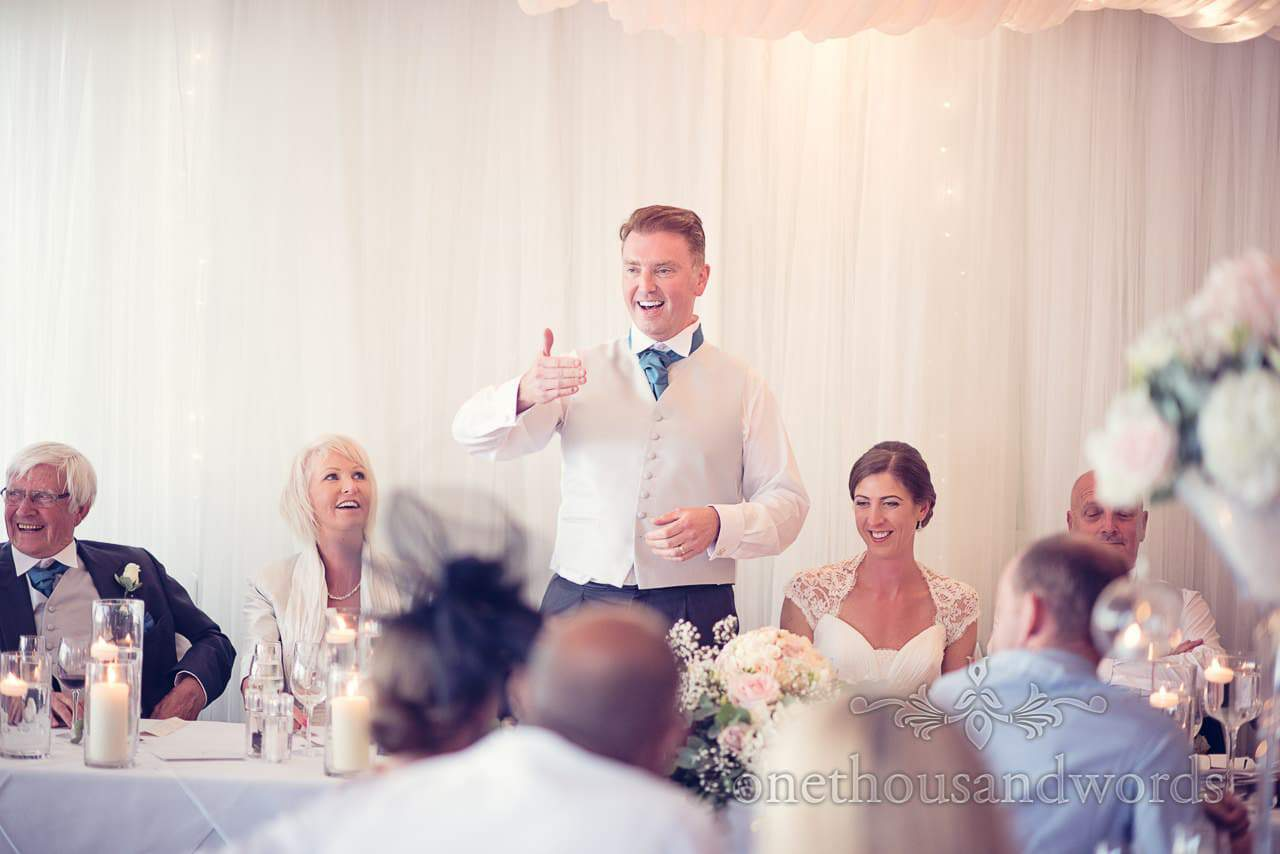 Animated groom during speech at Harbour Heights hotel wedding photographs