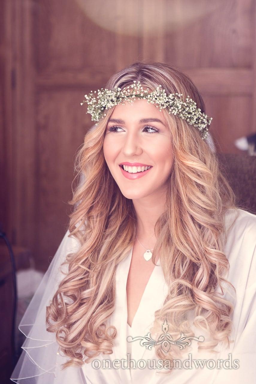 Beautiful Blonde bride with floral headband gypsophila wedding flowers