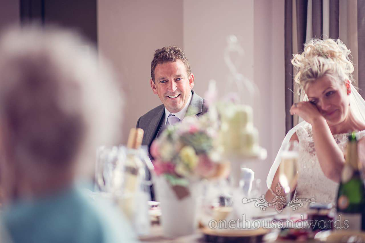 Best man laughs and bride cries during wedding speeches at Harmans Cross Wedding
