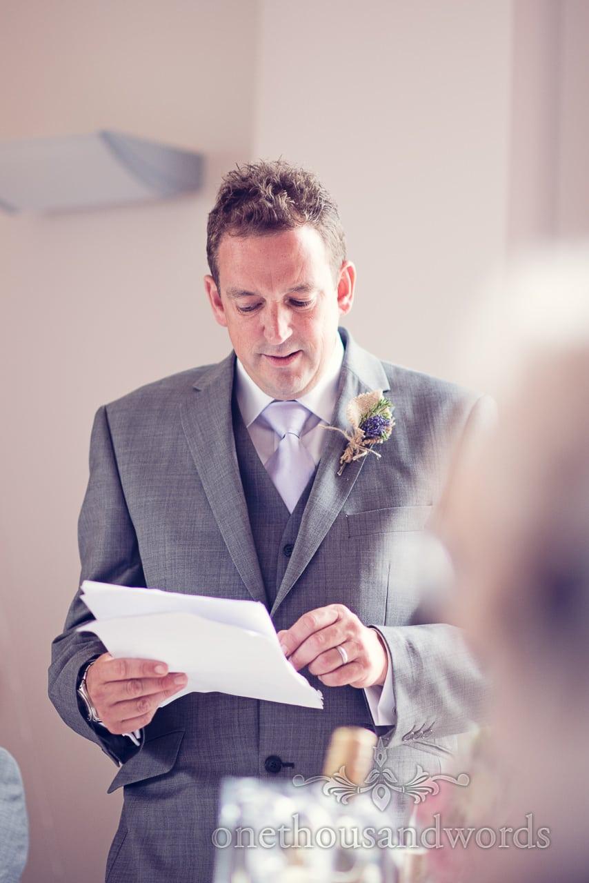 Best man makes speech at Harmans Cross Village Hall Wedding venue