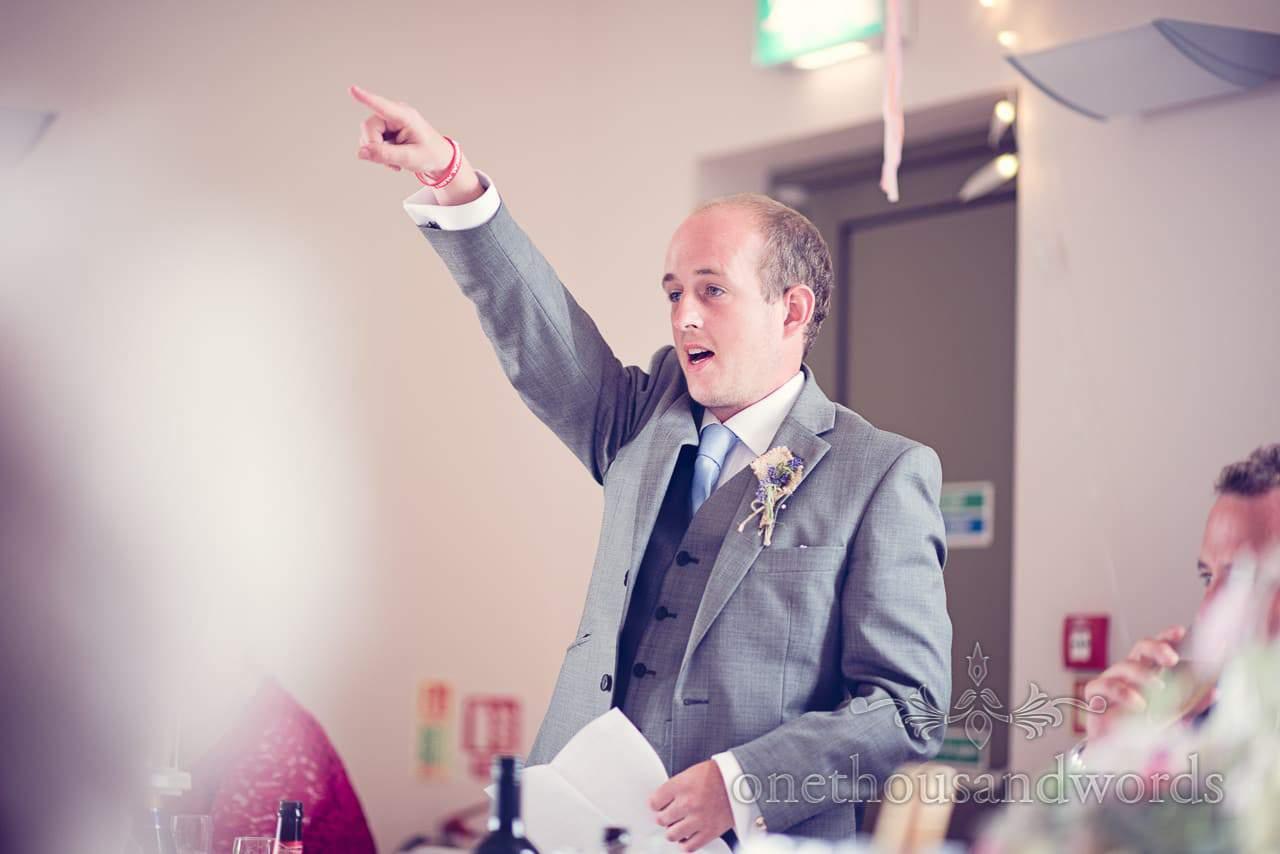 Best man pointing during best man's speech at Harmans Cross Wedding