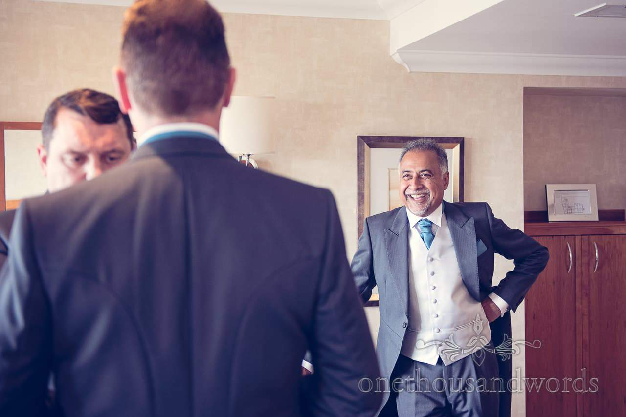 Best man smiles at groom at Harbour Heights wedding