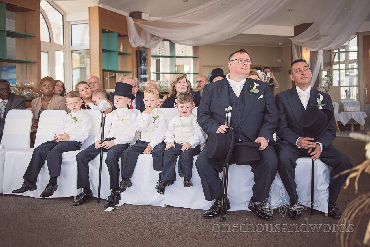 Best men and page boys with top hats and canes at Sandbanks Hotel Wedding ceremony