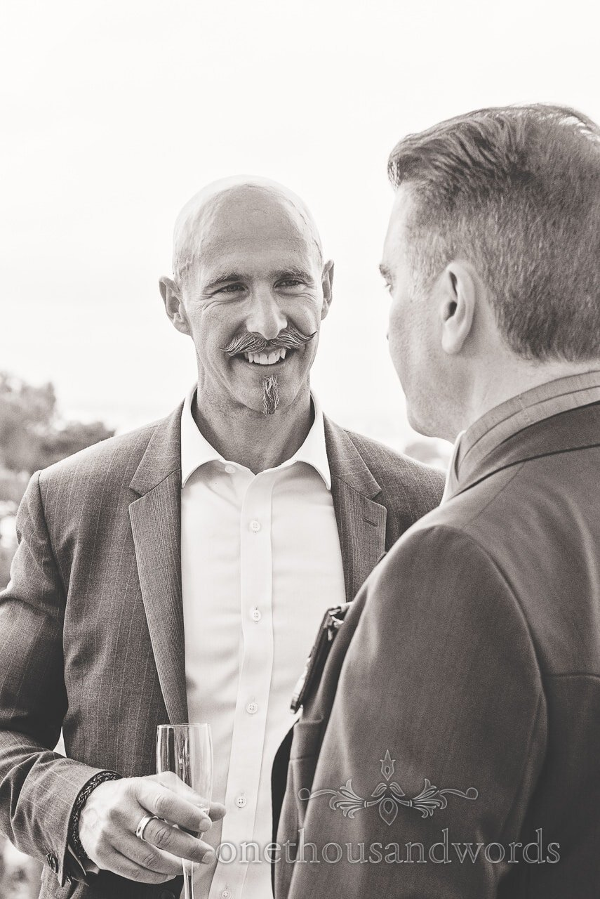 Black and white photograph of groom and guest at Harbour Heights wedding