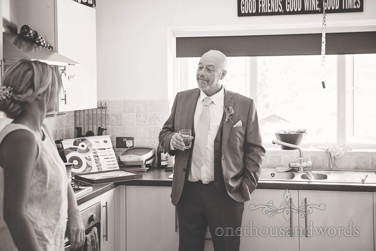 Black and white wedding photograph of father of the bride on wedding morning