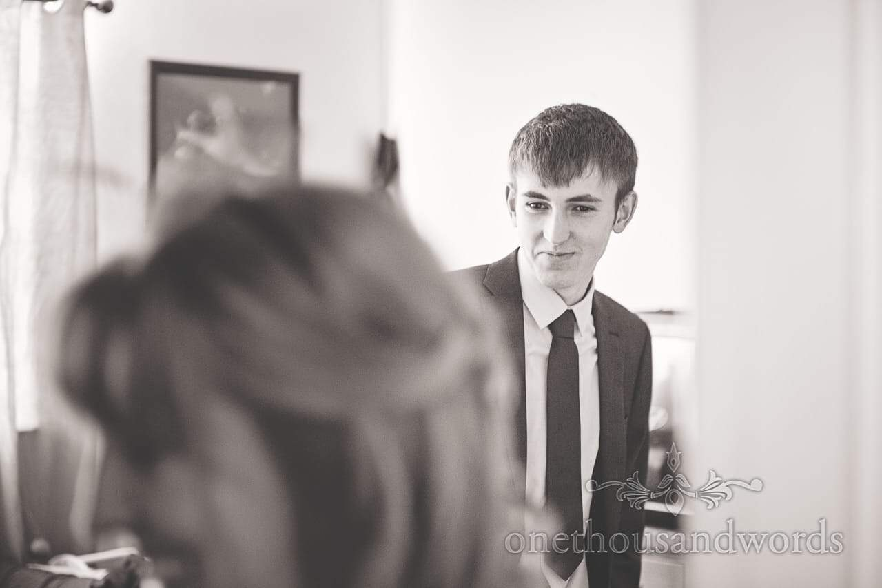 Black and white wedding portrait photograph of brides brother on wedding morning