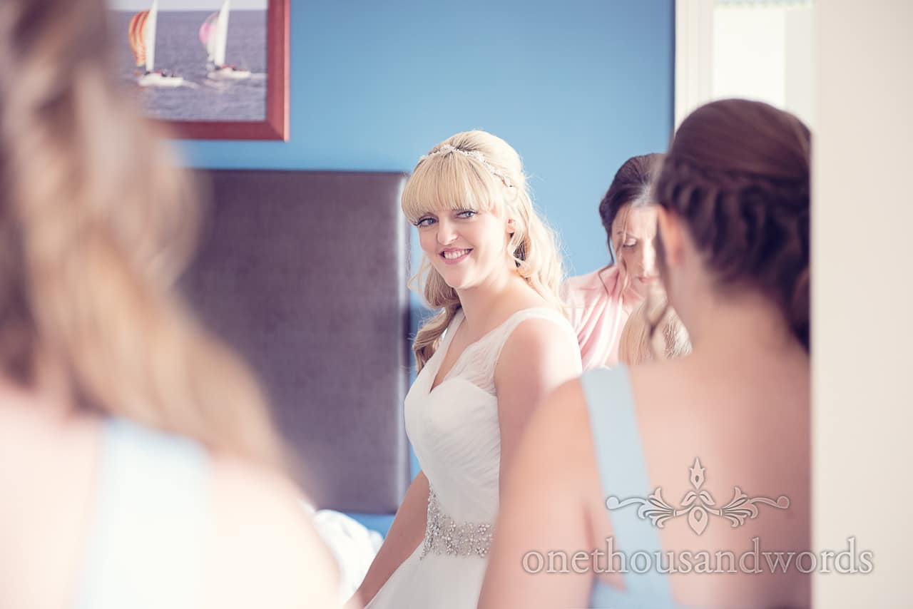 Blonde bride in white wedding dress and tiara on wedding morning at Sandbanks Hotel