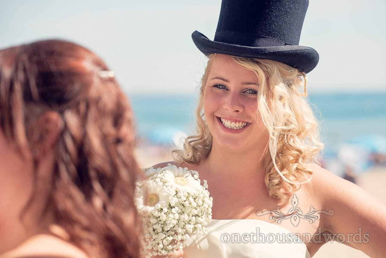 Blonde Bridesmaid wears top hat at Sandbanks Hotel Wedding