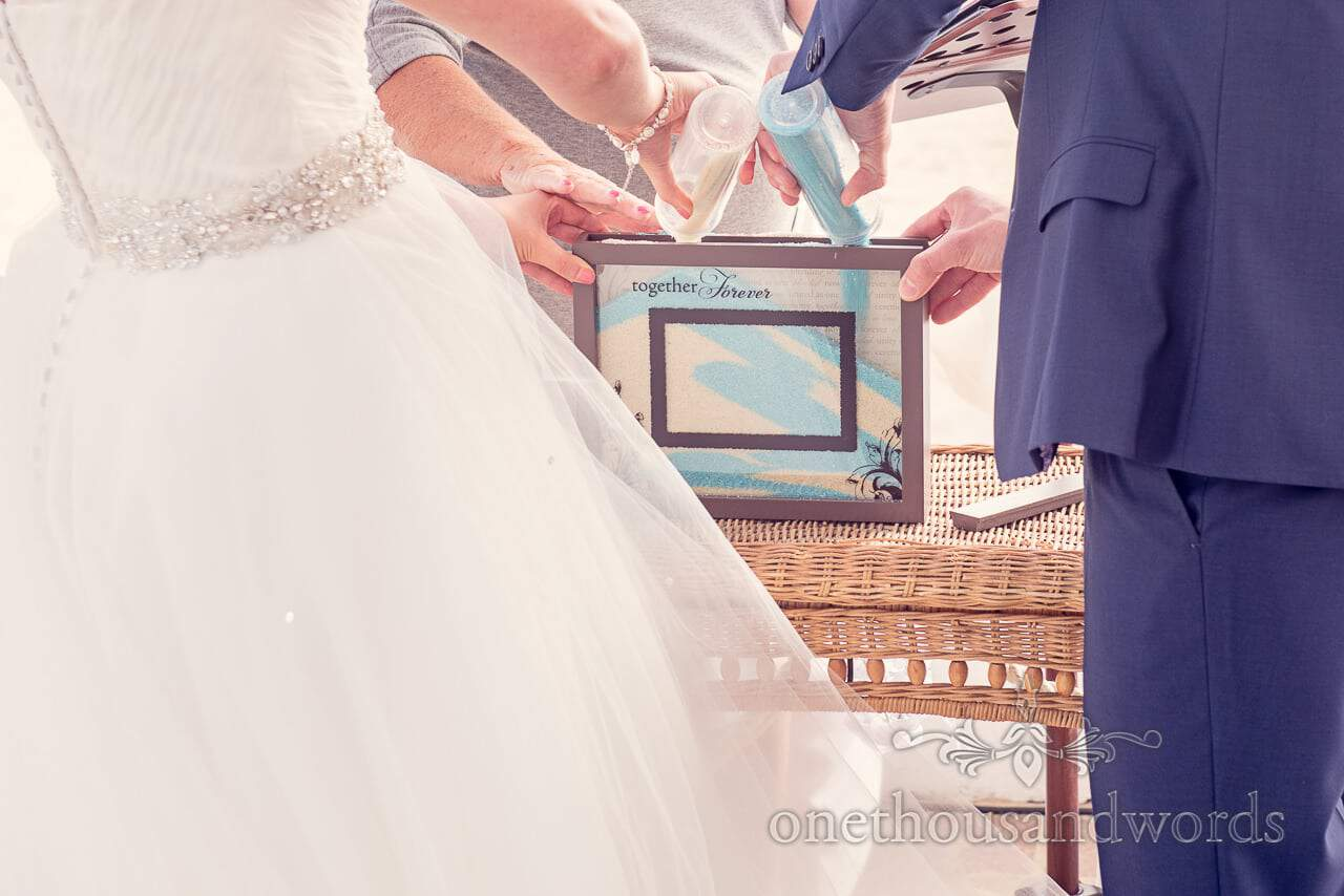 blue and yellow wedding sand ceremony at Sandbanks Hotel in Dorset