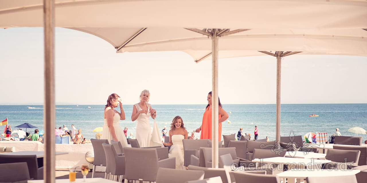 Bride and bridesmaids by the sea at Sandbanks Hotel Beach wedding in Dorset