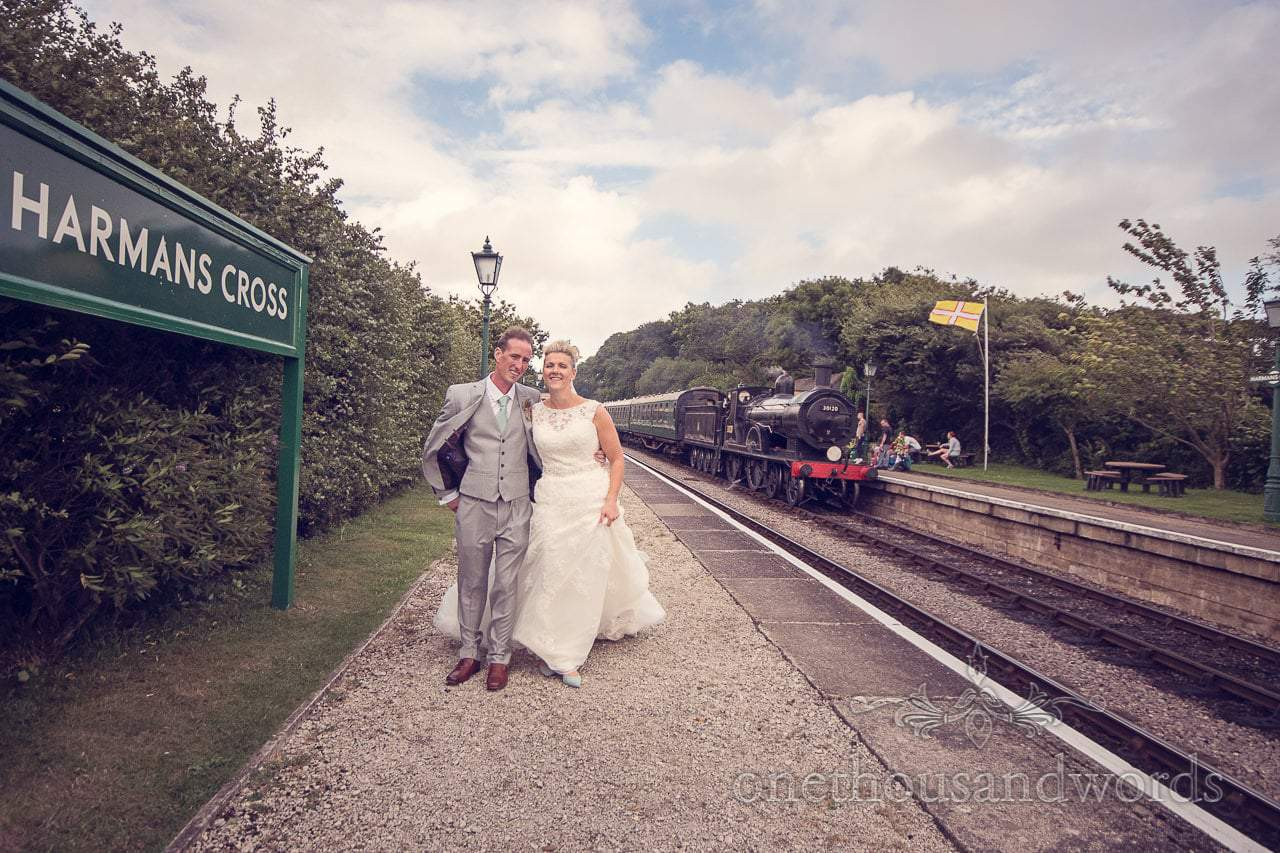 Bride and Groom at Harmans Cross Train Station with Steam Train and Dorset Flag