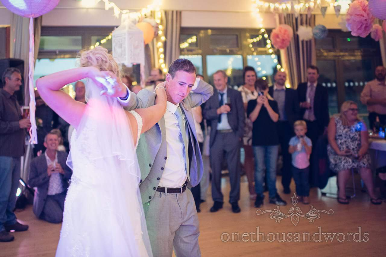 Bride and groom dance a choreographed first dance routine