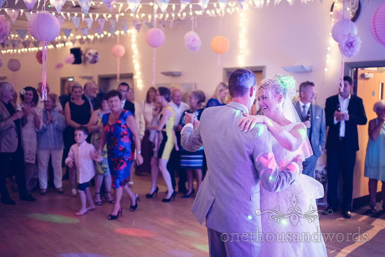 Bride and groom dance under bunting and chinese lanterns at Harmans Cross Wedding