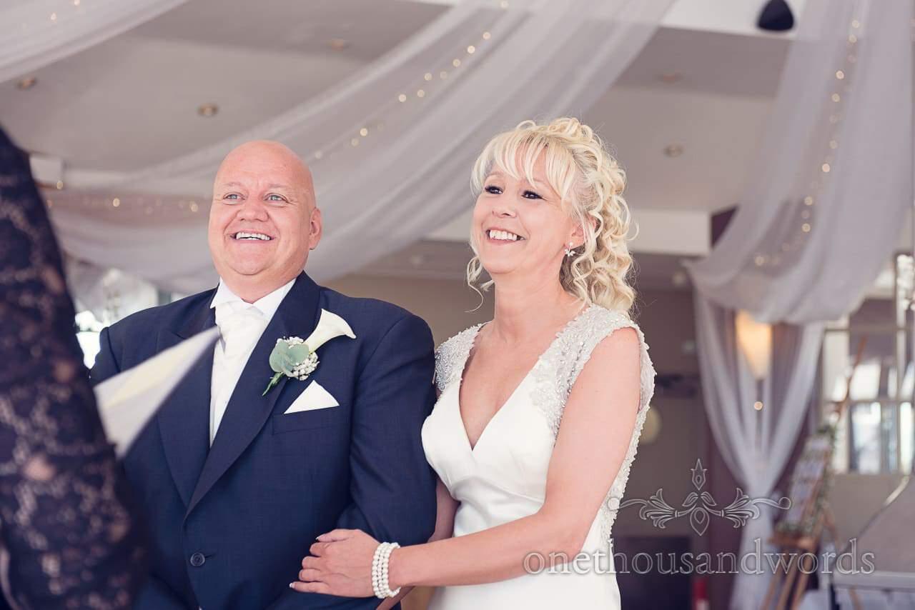 Bride and groom during ceremony at Sandbanks Hotel Wedding