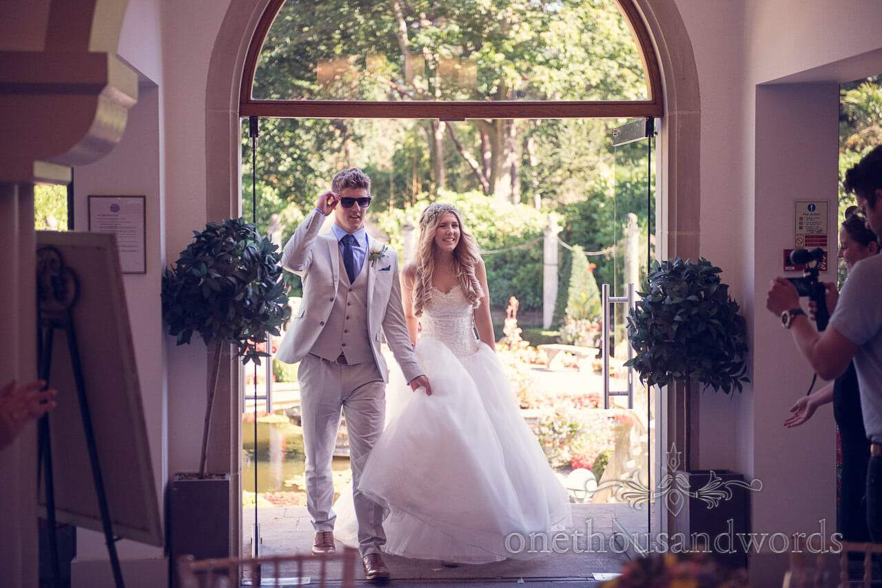 Bride and groom enter Italian Villa Wedding breakfast
