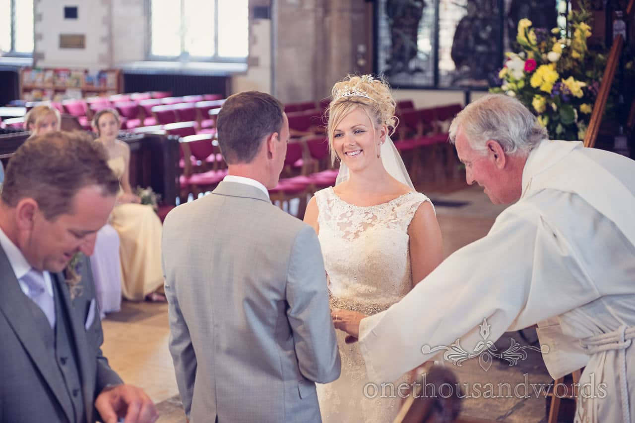 Bride and groom exchange vows during Swanage church wedding ceremony