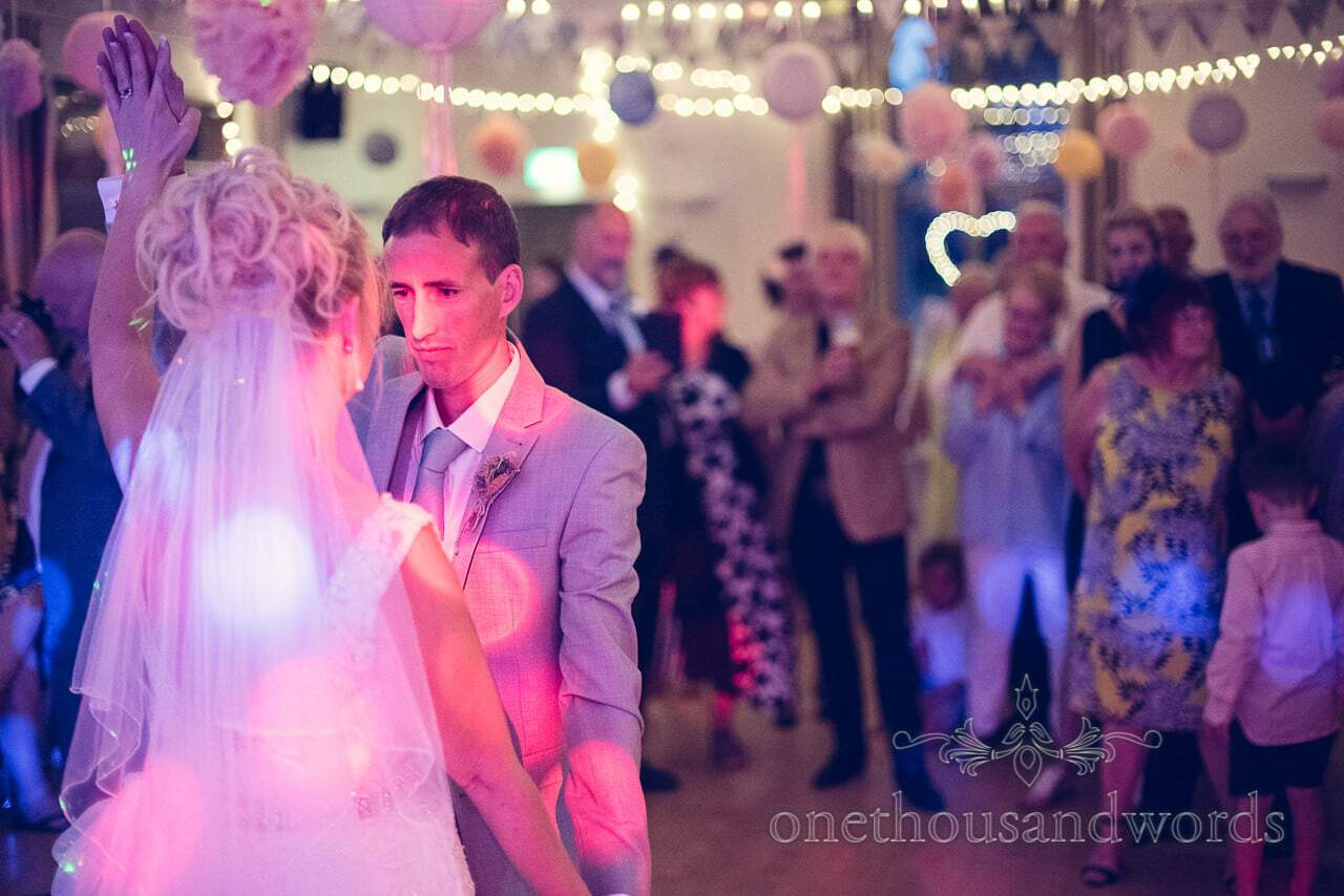 Bride and groom's first dance routine under disco lighting at Harmand Cross Wedding