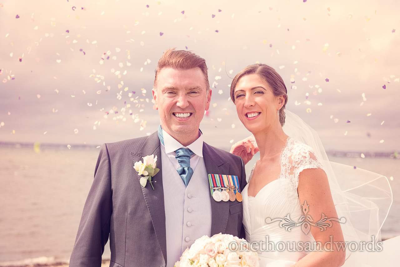 Bride and groom in confetti shower from Harbour Heights wedding