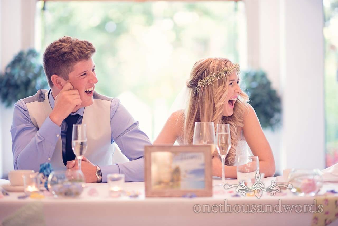 Bride and groom laugh at wedding speeches at italian villa wedding photographs