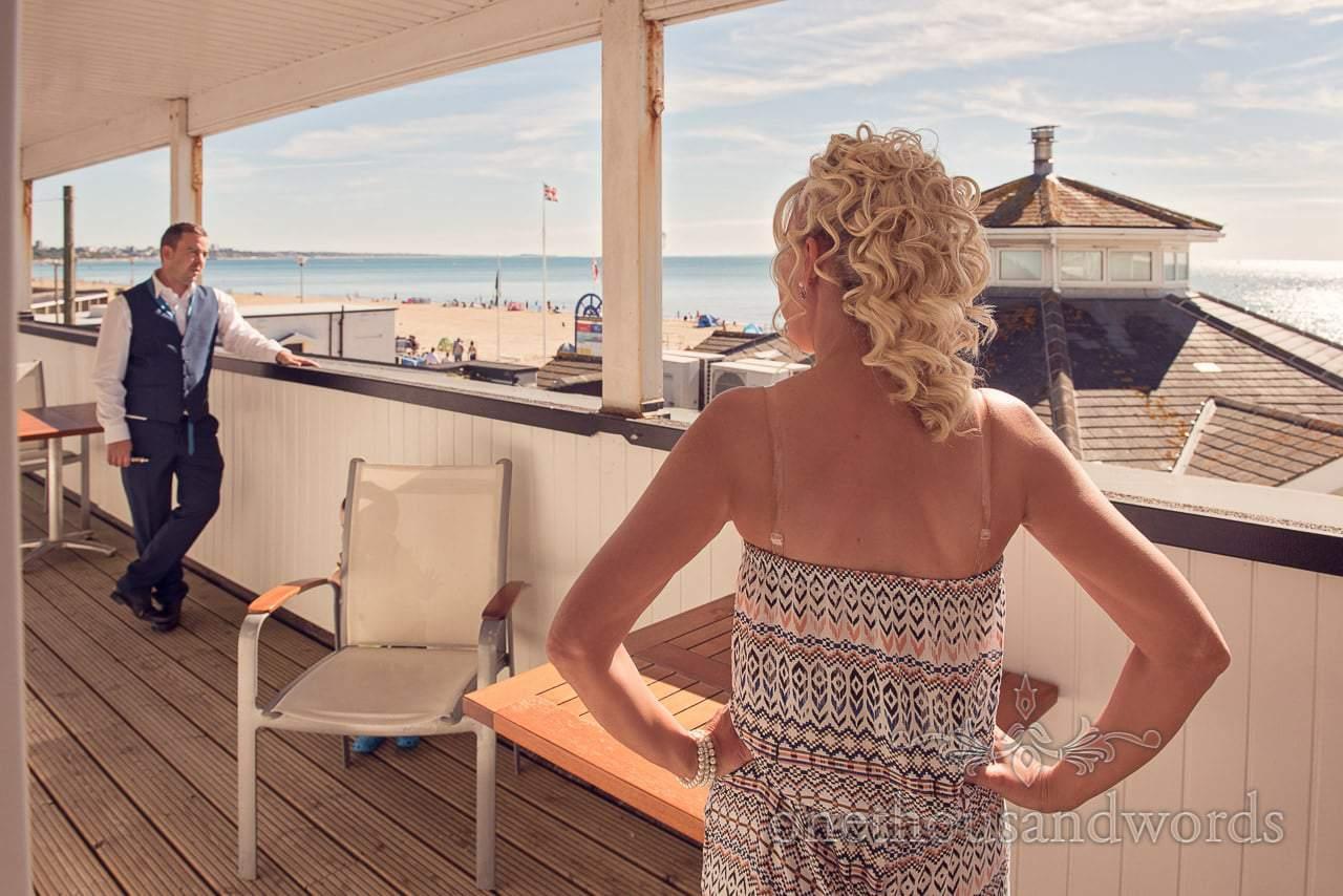 Bride and guest enjoy the beach view Sandbanks Hotel Wedding
