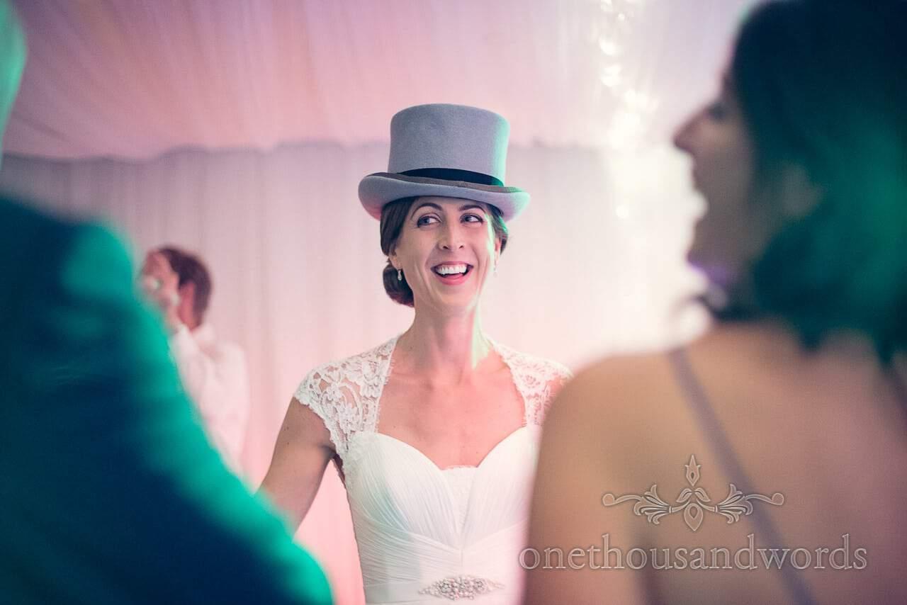 Bride dances in Top Hat at harbour heights wedding photographs