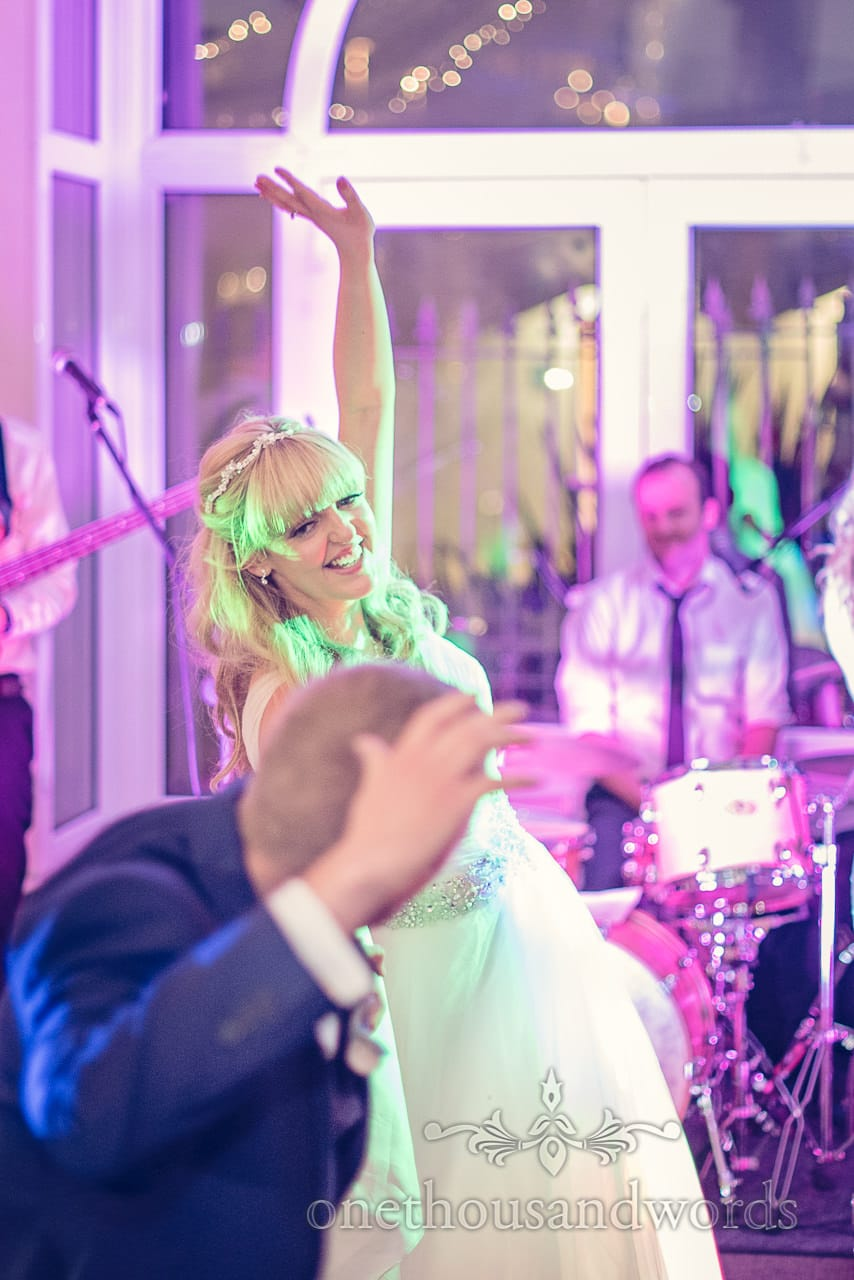 Bride dancing during wedding first dance at Sandbanks Hotel in Dorset