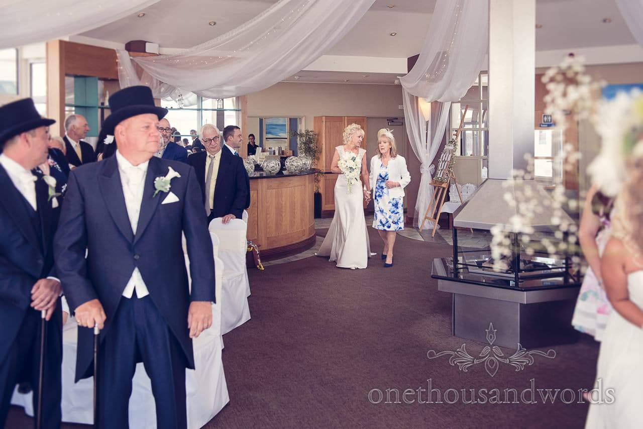 Bride escorted by mother at Sandbanks Hotel Wedding
