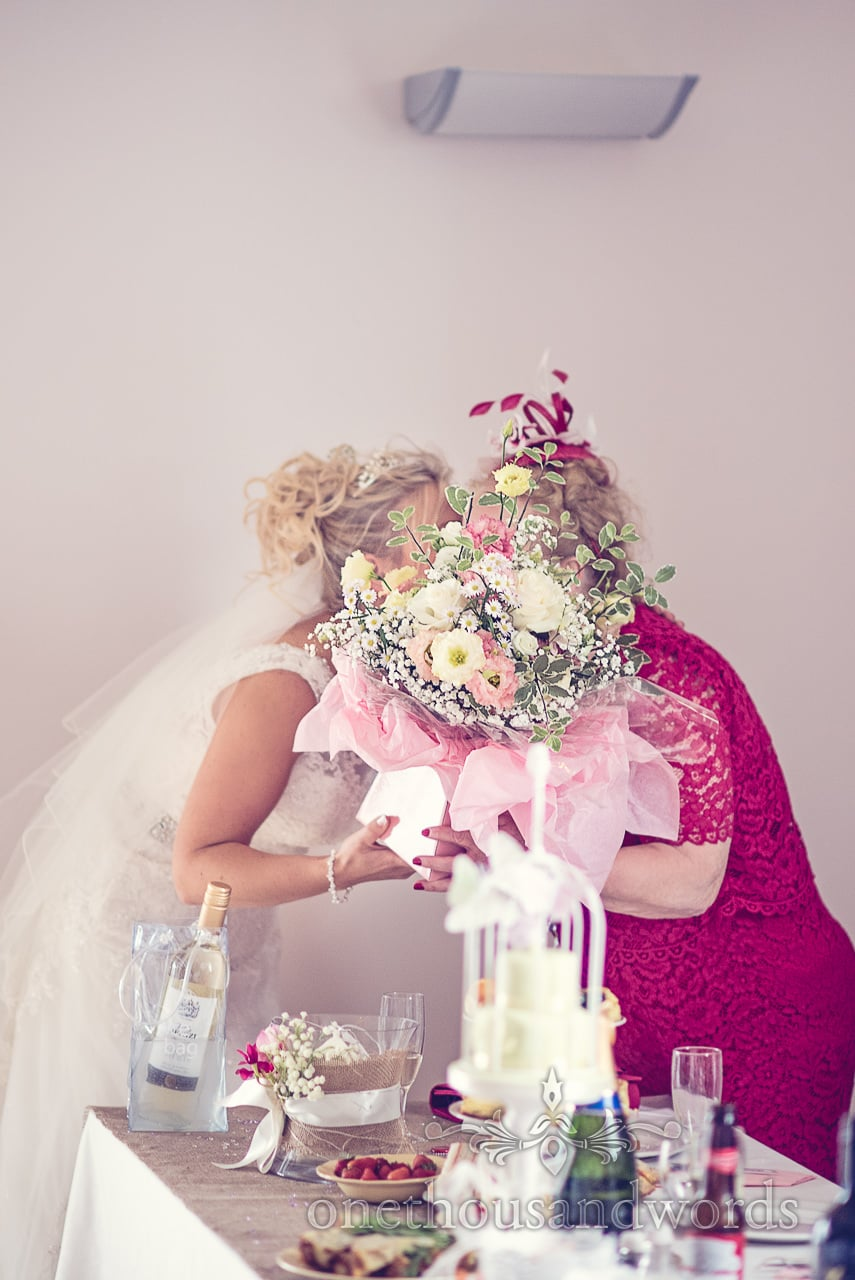 Bride gives groom's mother flower bouquet at Harmans Cross Wedding