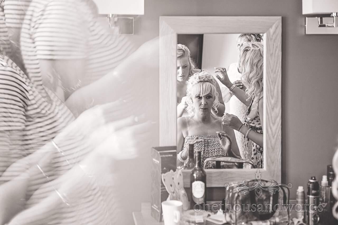 Bride in mirror on morning of Sandbanks Hotel Wedding