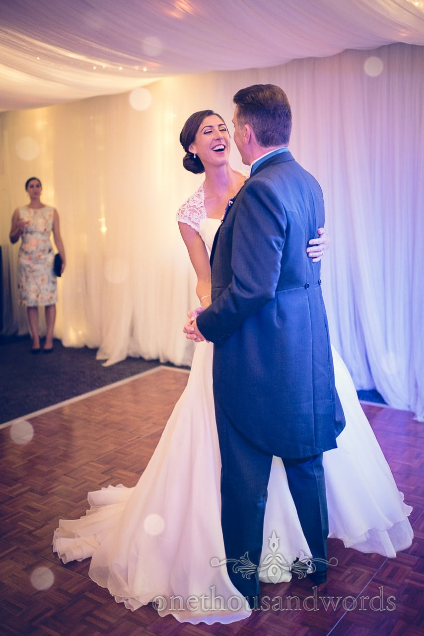 Bride laughs during first dance at harbour heights wedding photographs