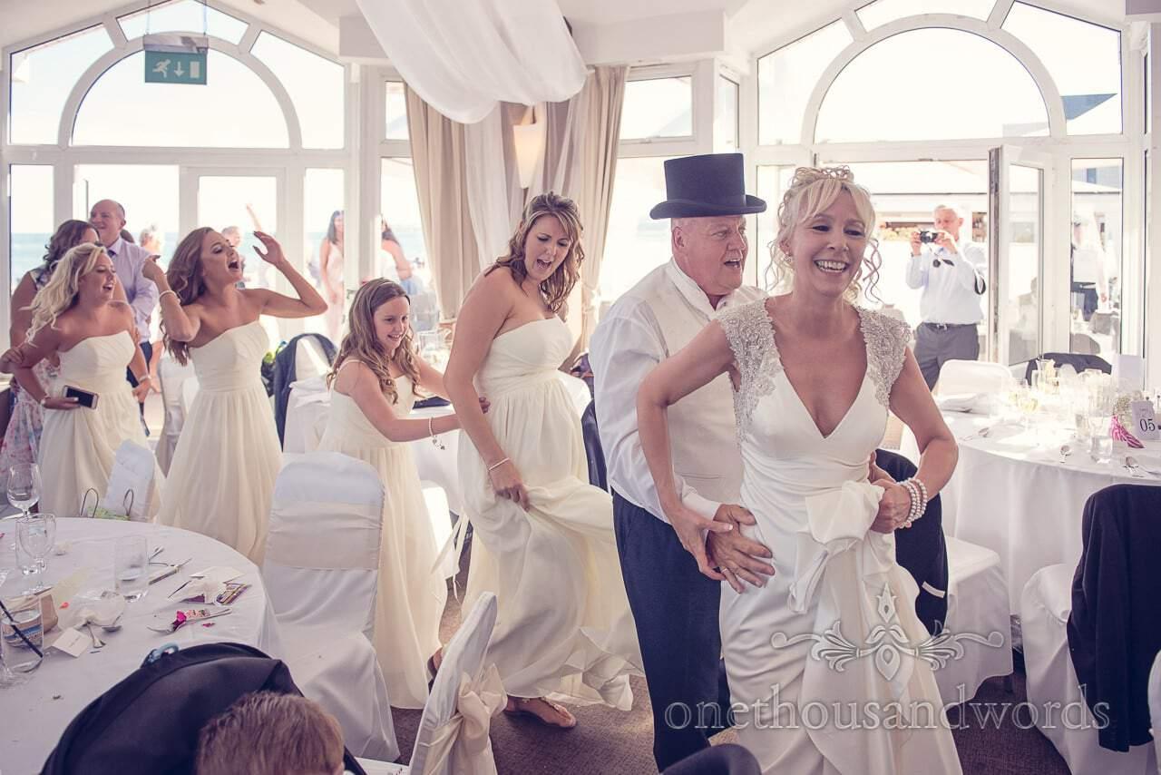 Bride leads conga line at Sandbanks Hotel Wedding photographs