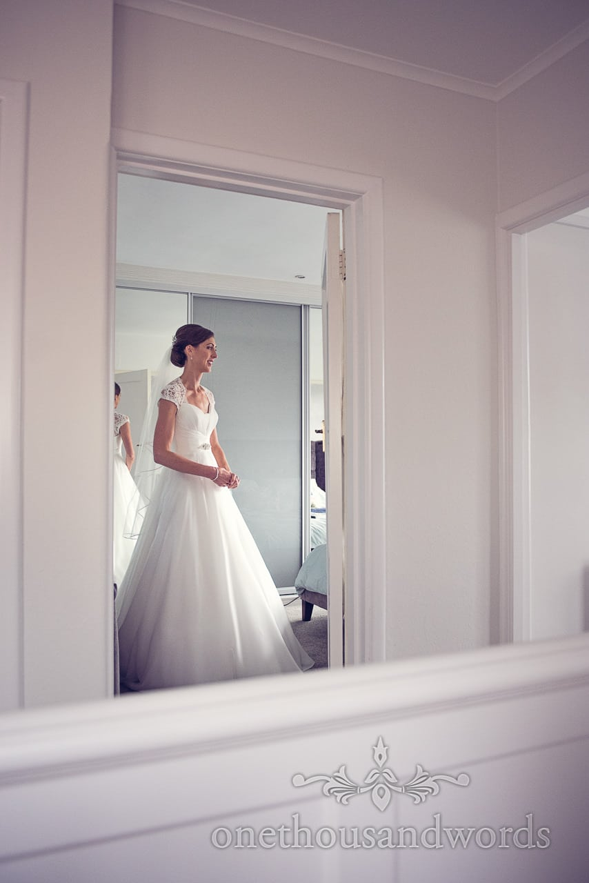Bride through doorway on morning of Harbour Heights wedding photographs