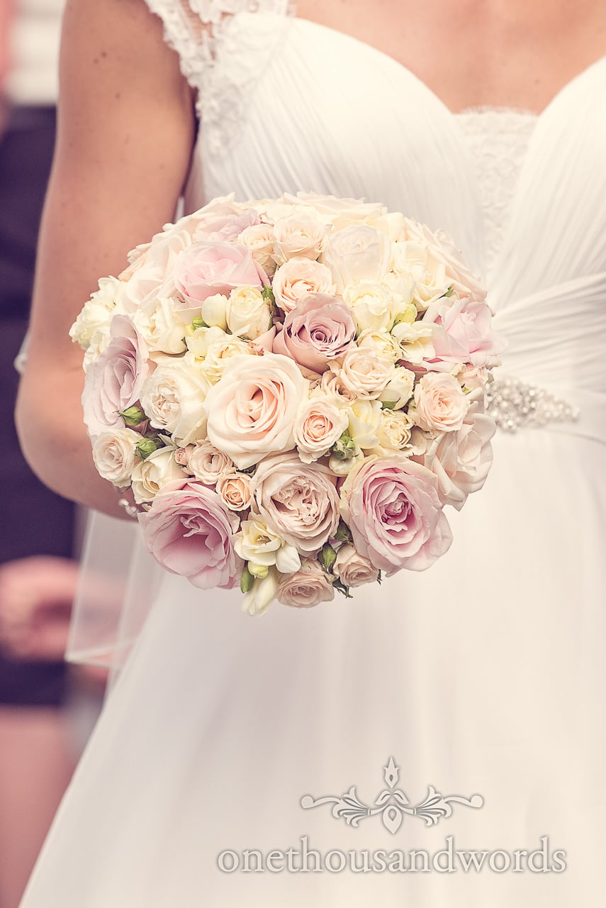 Brides bouquet of pink and yellow flowers at Harbour Heights wedding