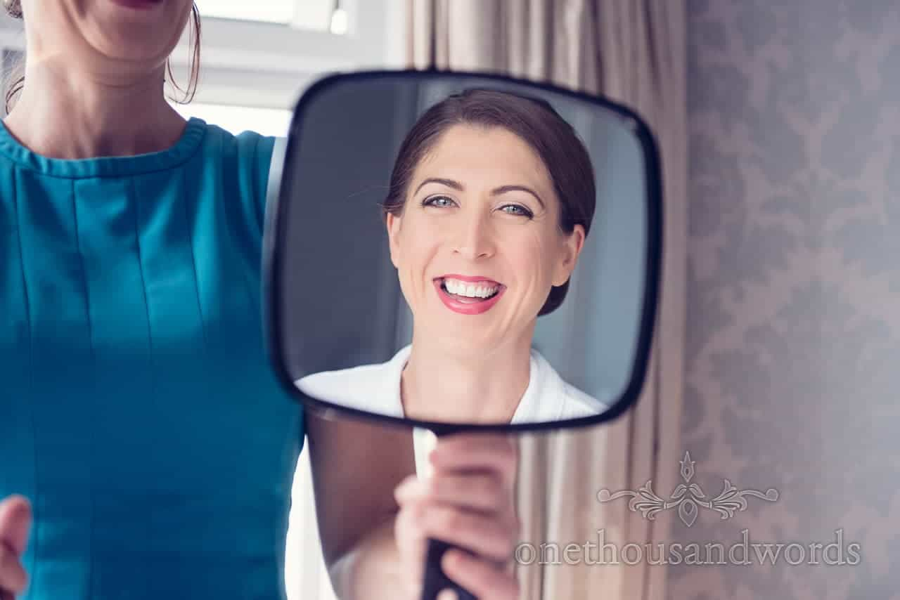 Brides face in handheld mirror from Harbour Heights wedding photographs