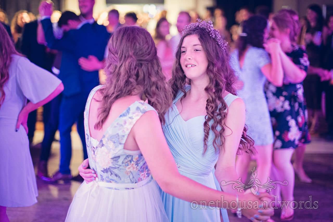 Bridesmaid dancing under purple lights at italian villa wedding photographs