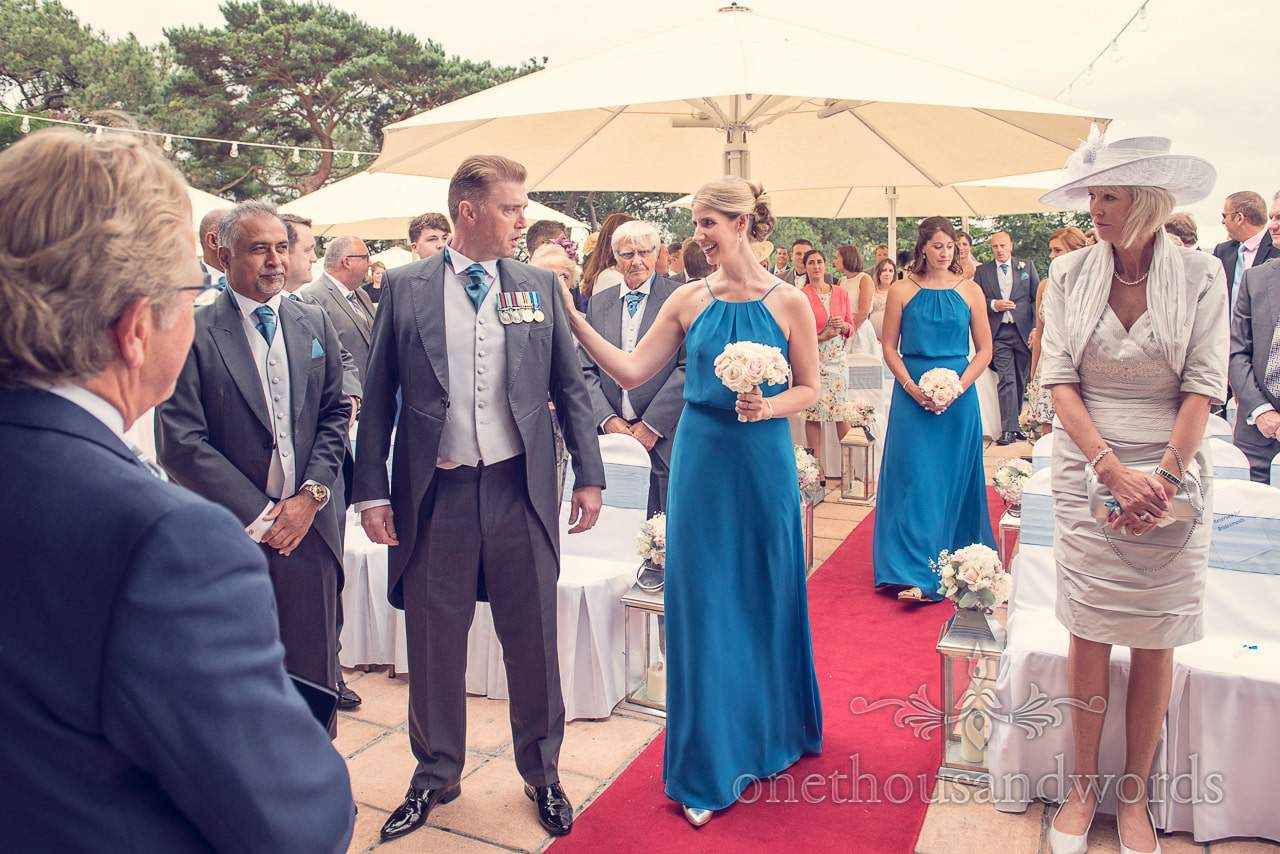 Bridesmaid greets groom during civil ceremony at Harbour Heights wedding