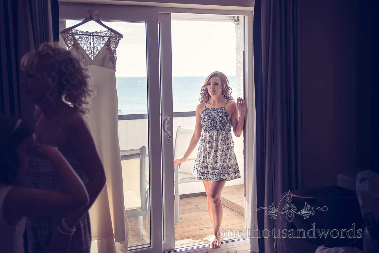 Bridesmaid in balcony door at Sandbanks Hotel Wedding