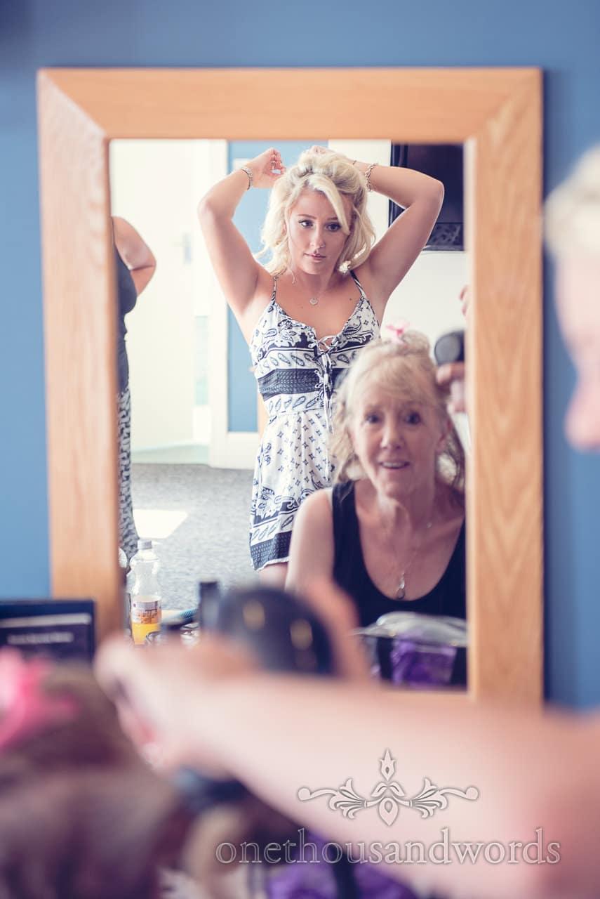 Bridesmaid in mirror on morning of Sandbanks Hotel Wedding