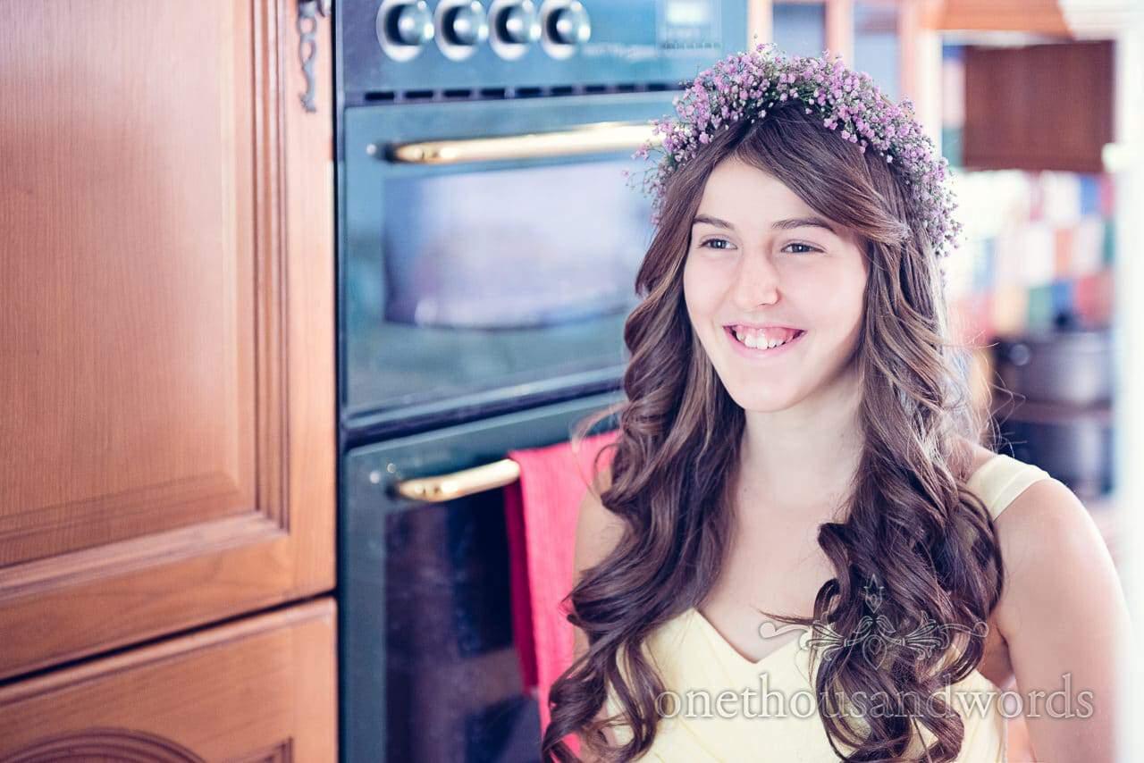 Bridesmaid in pastel yellow bridesmaid dress with pink gypsophila headband