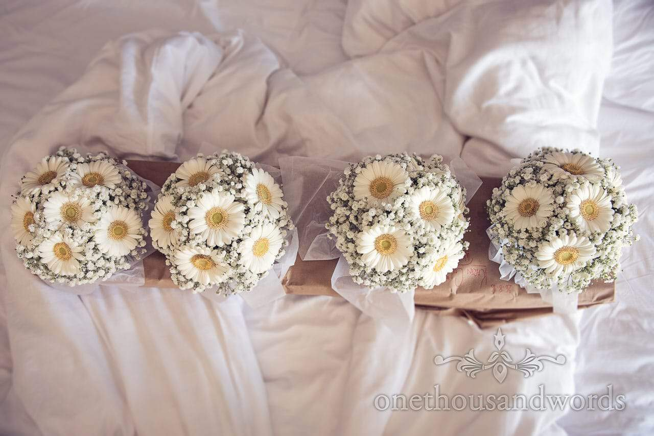 Bridesmaids bouquets on the bed at Sandbanks Hotel Wedding