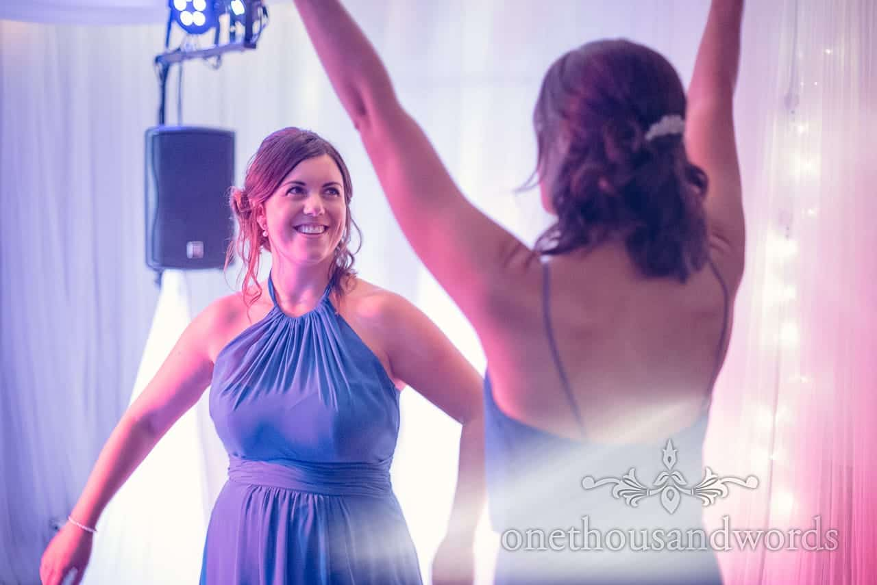 Bridesmaids in blue bridesmaids dresses dancing at harbour heights wedding photographs