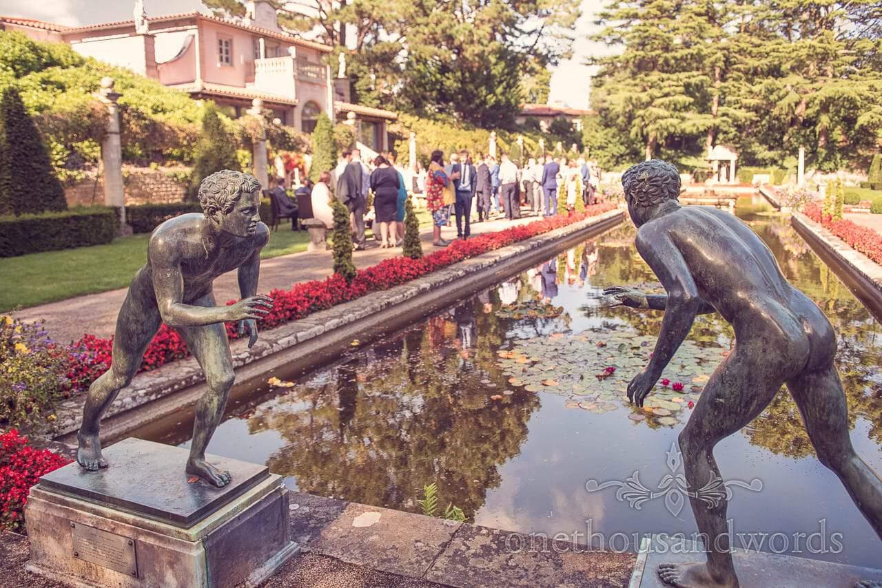 Bronze scupltures in Italian Gardens drinks reception at italian villa wedding photographs
