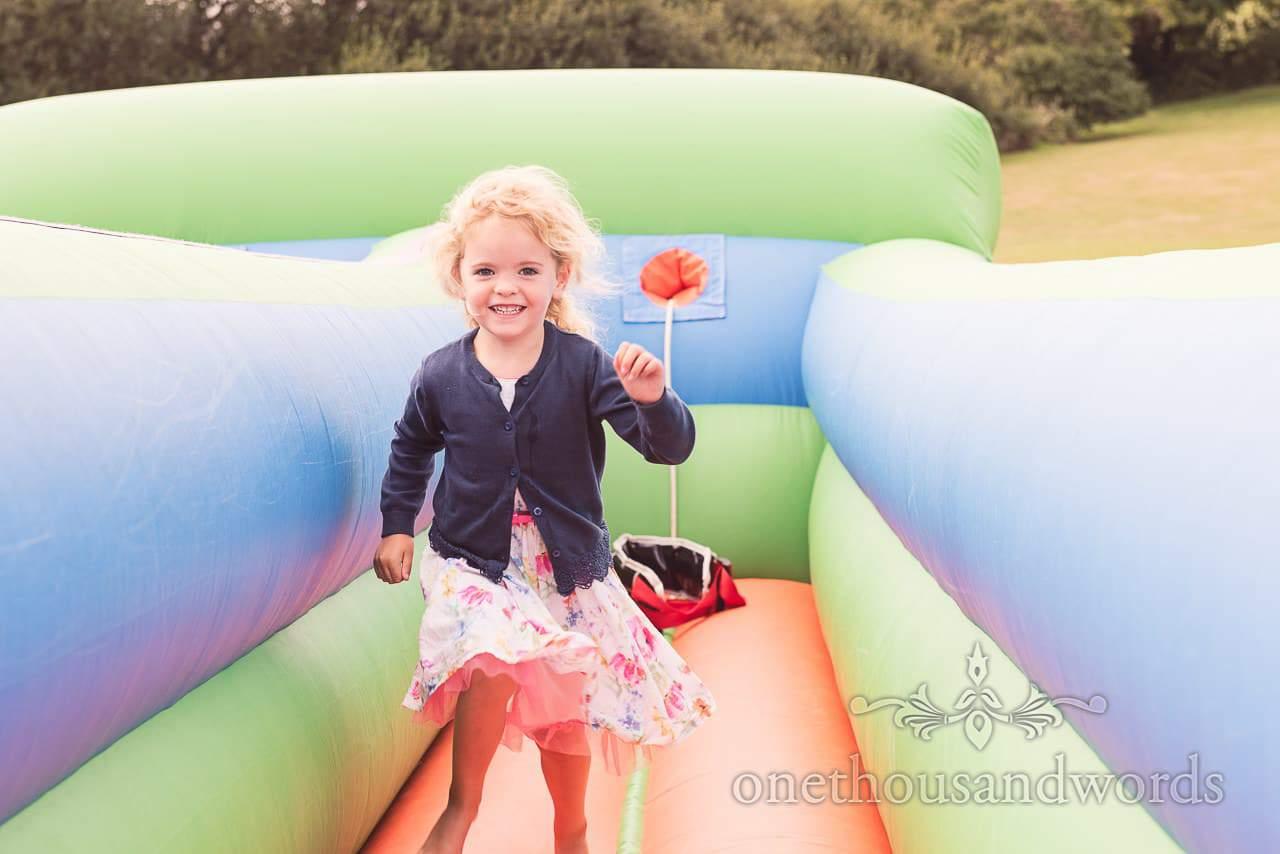 Child on inflatable wedding entertainment at Harmans Cross Wedding