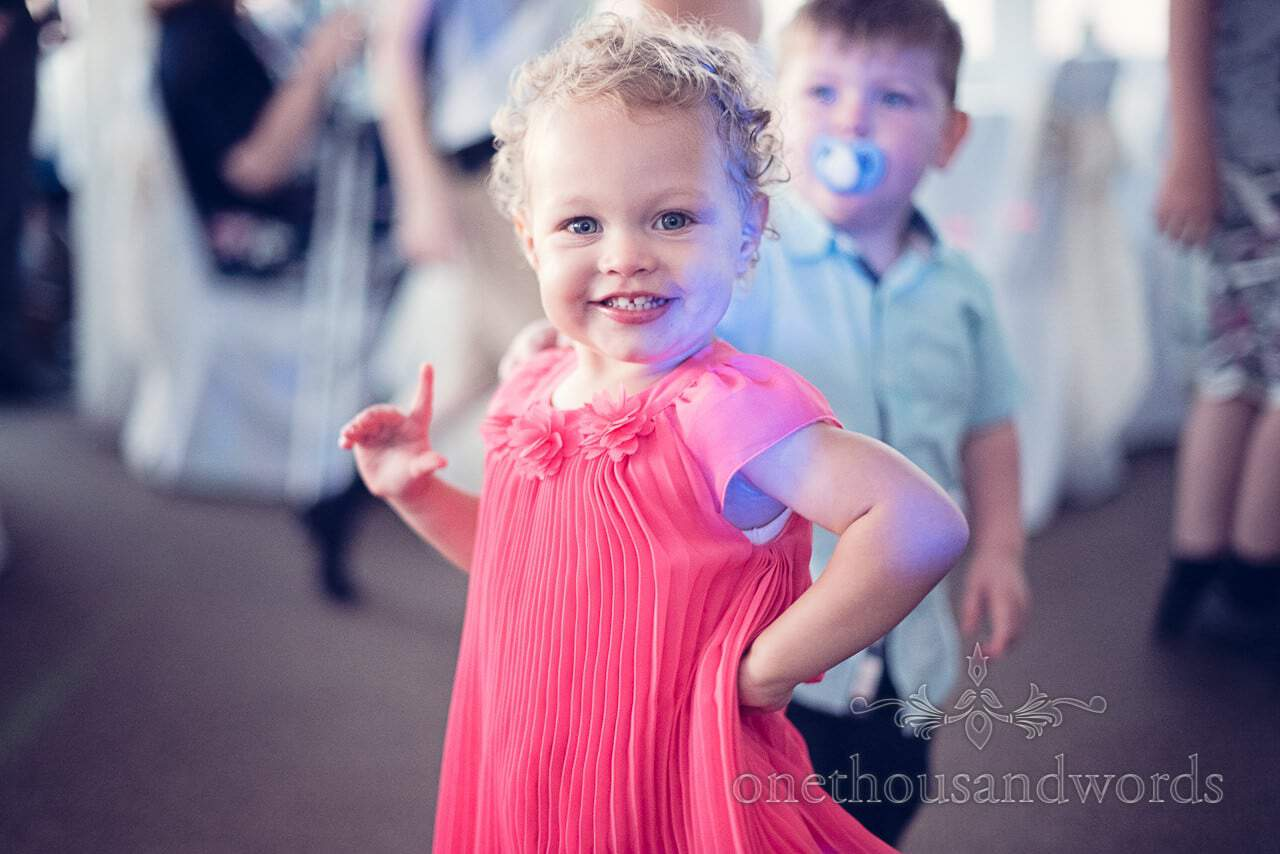 Child wedding guest dancing to wedding disco at Sandbanks Hotel Wedding