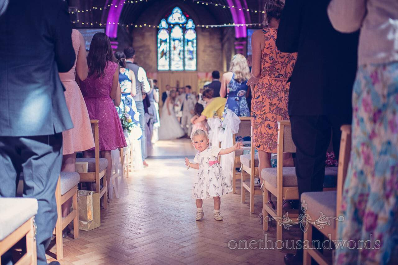Child wedding guest in aisle at St Marys Lonfleet church wedding ceremony in Poole