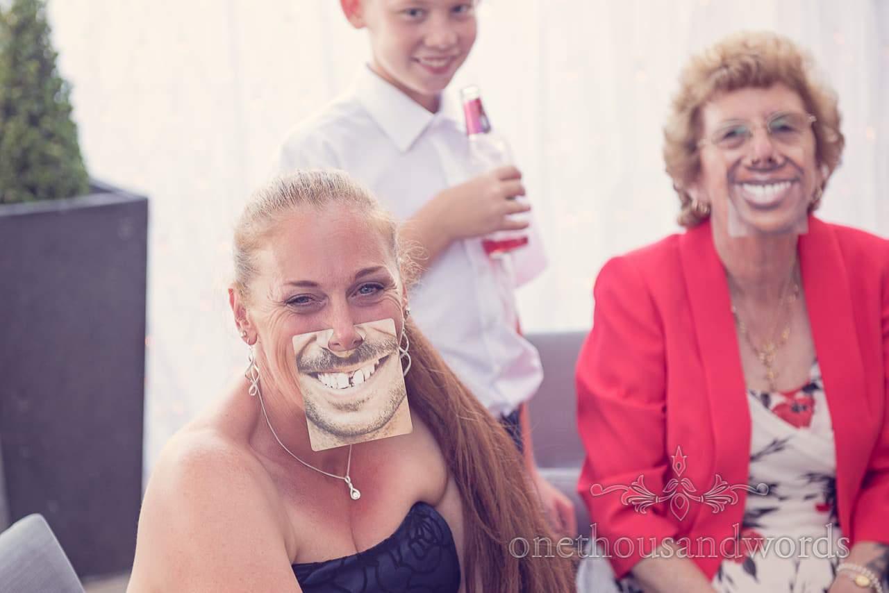Comedy face beer mats at Sandbanks Hotel Wedding