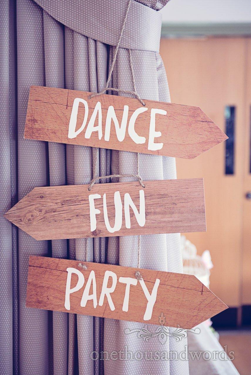 Dance, Fun, Party wooden arrow signs at Harmans Cross Wedding photographs